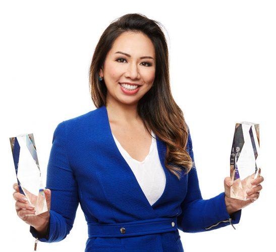 Eileen Hsu holding two awards